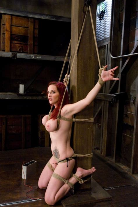 Tattooed Redhead Slut Tied Up With Rope