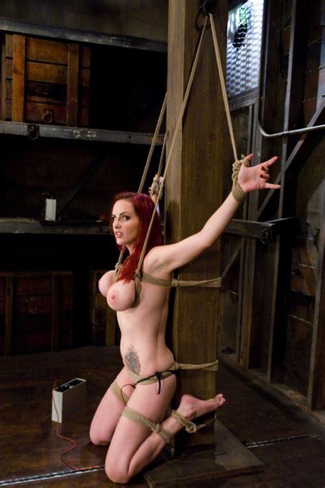 Tattooed Redhead Slut Tied Up With Rope