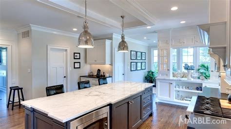 Classic Marble Island with Contrasting Granite Countertops