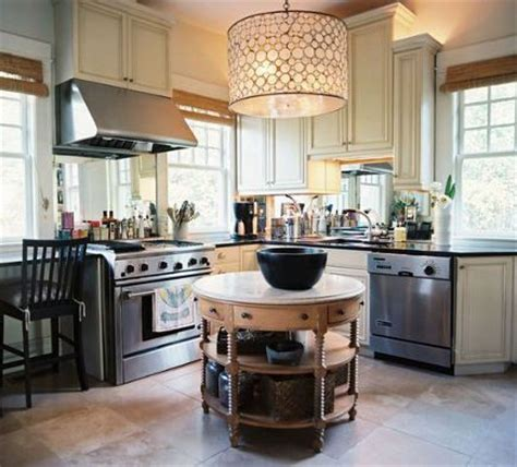 Kitchen With Antique Table In The Round Used As An Island