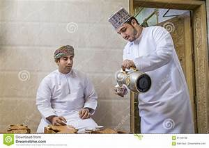 Omani Man Serving Traditional Coffee Called Qahwa To ...