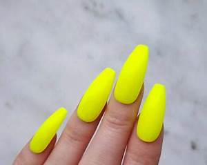 Yellow stiletto nail