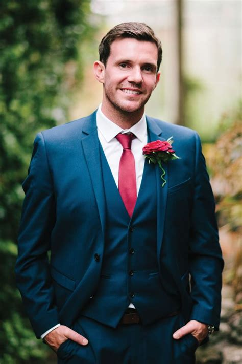 wedding lawsuit groom in a navy suit with tie via weddingideasmag the merry