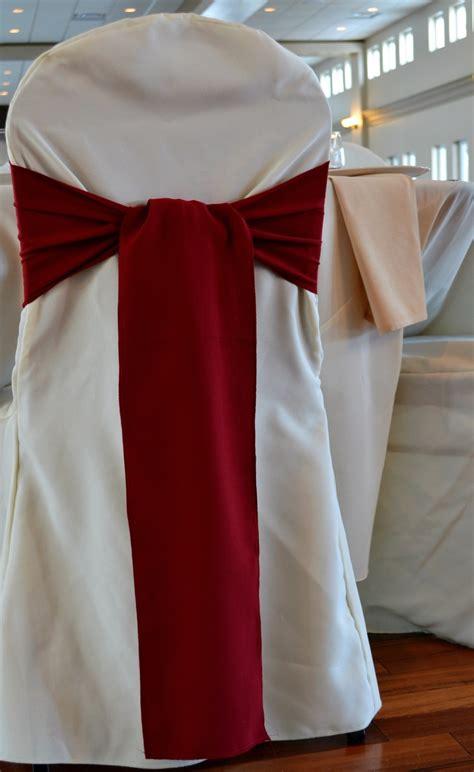 burgundy sash on ivory chair cover wedding