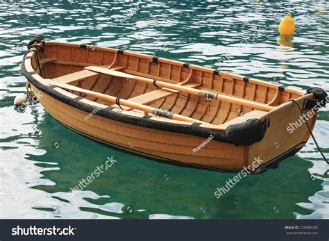 Small Fishing Boat Pics by Small Fishing Boat On The Sea Water In A Secluded Bay