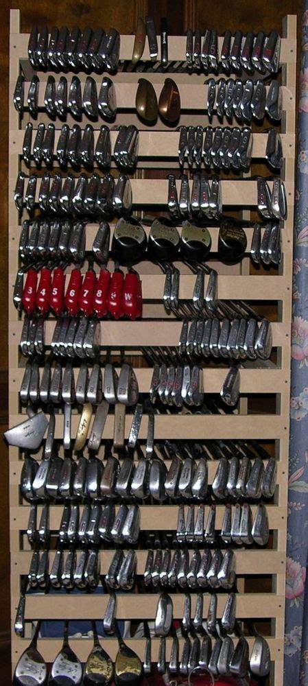 Large Golf Club Storage Rack! Holds Up To 300 Clubs! Ben. Zebra Area Rug. Wood Plank Ceiling. Red Backsplash. Unique Chandelier. Modern Hardwood Floors. Ikea Stolmen. Benjamin Moore Monroe Bisque. Multi Use Furniture