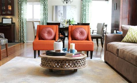 orange transitional chairs and rustic coffee table