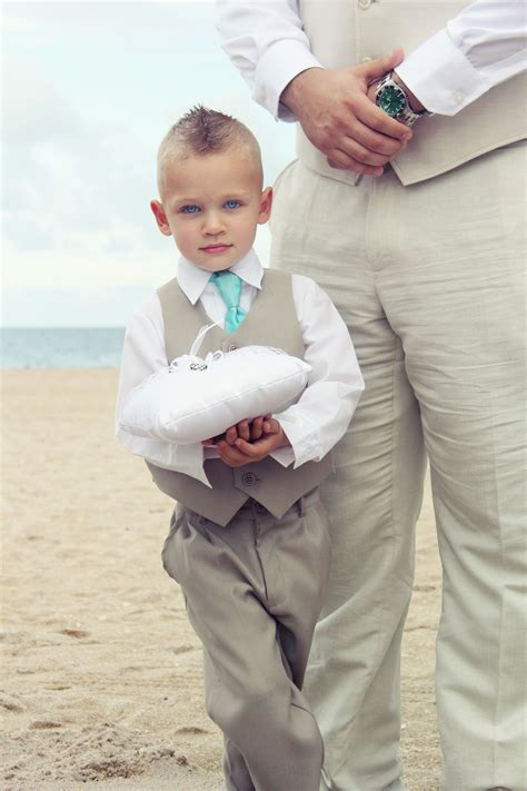 ring bearer in matching color pants and vest and tie color as groom wedding wedding attire