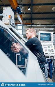Worker Resetting A Cnc Lathe Machine In Manufacturing