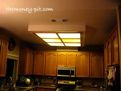 As electrical components like light fixtures age, they can become unsafe. Updating a Fluorescent Box Light With LED Lighting Decorative Molding   Hometalk