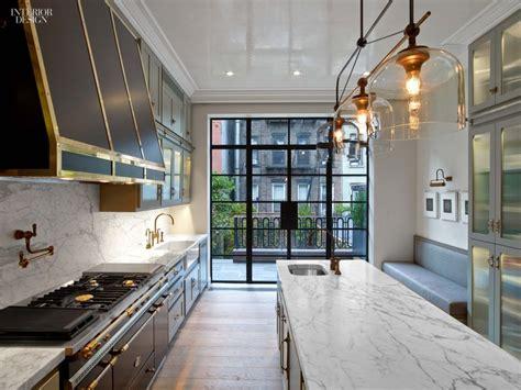 long kitchen  black  gold range hood  stove