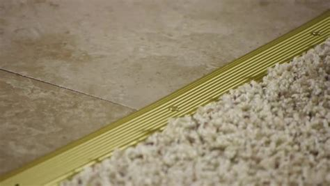 Wood To Tile Metal Transition Strips by How To Install A Transition From Carpet To