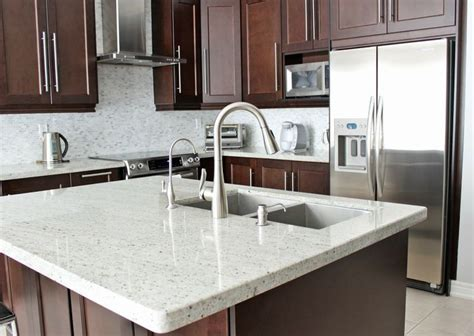 brown kitchen cabinets with white countertops medium brown cabinets with white quartz countertop 156 | cf4777277cedb4e2e6a8f5b2acaf16d6 kashmir white granite white countertops