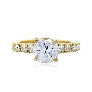 solitaire yellow gold engagement rings gold ring on finger hd with yellow gold engagement rings diamantbilds