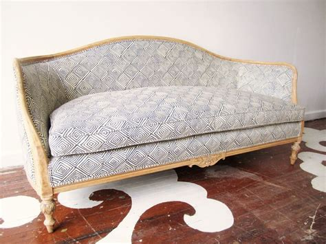 Reupholster Settee by Reupholster Antique Sofa Between Blue And Yellow