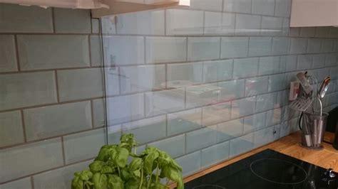 cream kitchen  green metro tiles  grey grout glass