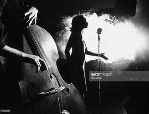 Singer And Bassplayer In Smokey Atmosphere Of Nightclub ...