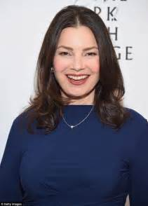 hoop diamond earrings fran drescher in form fitting dress at broadway play
