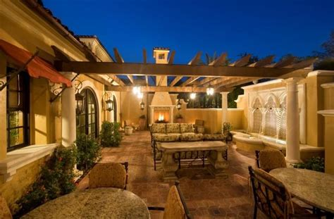 center courtyard homes google search exterior fireplace patio fountain french doors