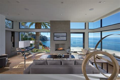 view interior of homes living room glass walls ocean views beach house in laguna beach california
