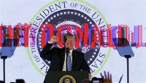 donald trump appears  presidential seal featuring