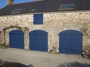 Porte de garage boreal ouvertures le hezo vannes 56 for Porte de garage de plus porte en bois prix