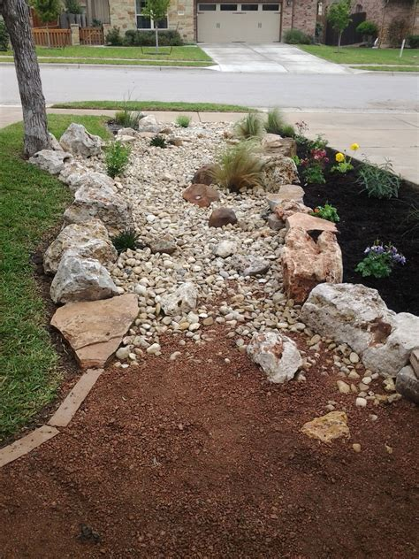 granite landscaping front yard landscape dry creek bed using really cool limestone boulders and accent moss