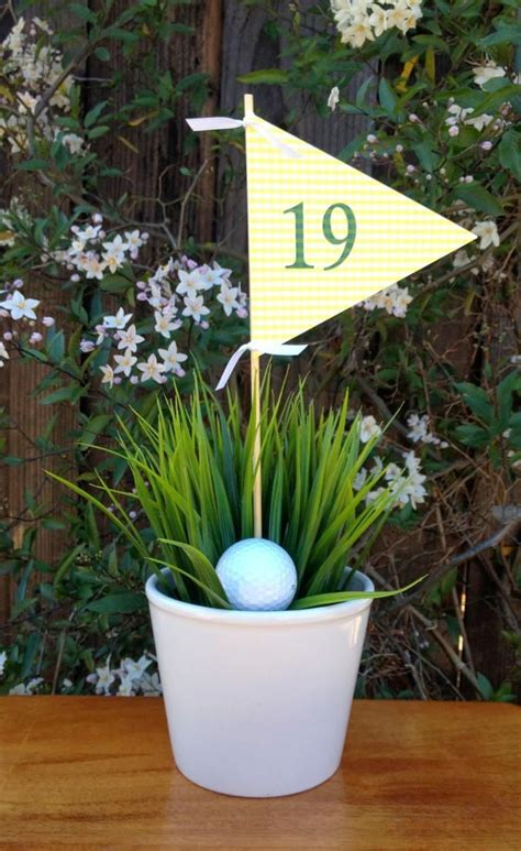 Decorate with sand, seashells and lighthouses. Golf Party at the 19th Hole (With images)   Golf decor, Golf centerpieces, Golf theme party