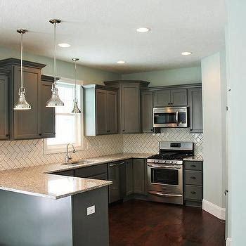 gray kitchen peninsula  butcher block countertop