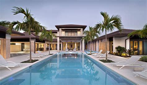 tuscan kitchen island custom home in florida with swimming pool
