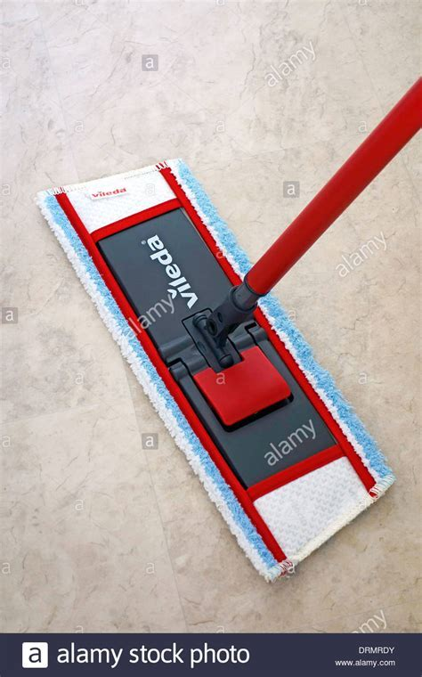 Vileda Mop Mopping a Marble Effect Vinyl Floor Stock Photo