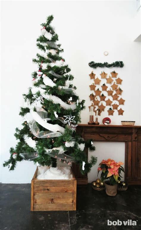 how to stand a real christmas tree make a diy tree stand with this easy tutorial bob vila