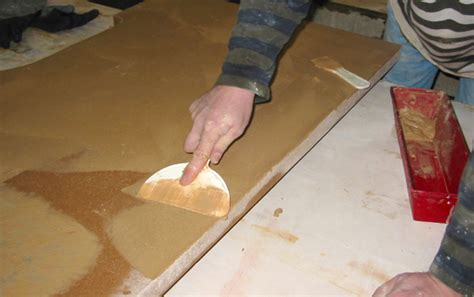 how to fill holes in concrete countertops how to grout to fill pinholes in a concrete countertop