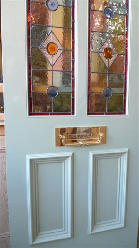 victorian style stained glass front door incorporating    glazed panels