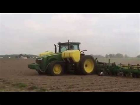cotton planters planting cotton with a 18 row deere planter