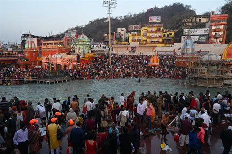 Tens of thousands of Hindu devotees take holy plunge in ...