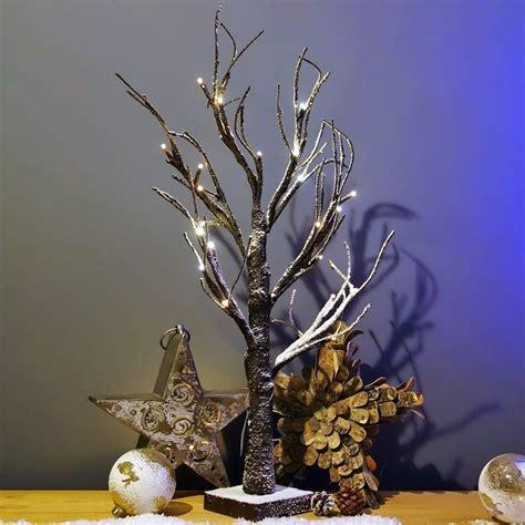light up snow covered twig tree