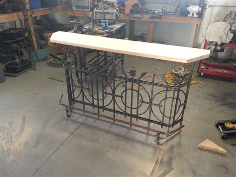 wrought iron railing up cycle to a patio bar
