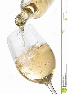 Pouring White Wine Into A Glass Stock Photos - Image: 17021443