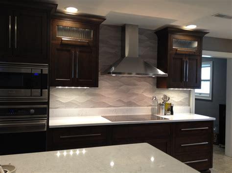 remodeled kitchen wavy porcelanosa backsplash ge monogram