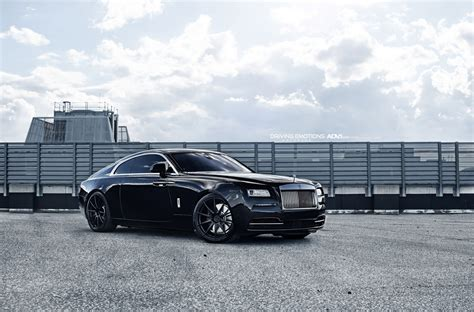 rolls royce wraith rolls royce wraith poses on 22 quot matte black wheels