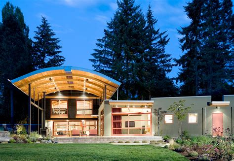 arch roof house house made of eclectic materials with arched metal roof digsdigs