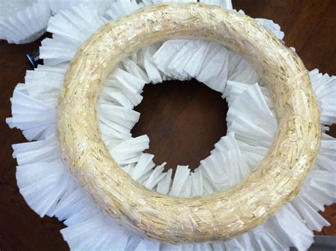 I started by folding half of my coffee filters. DIY Coffee Filter Wreath