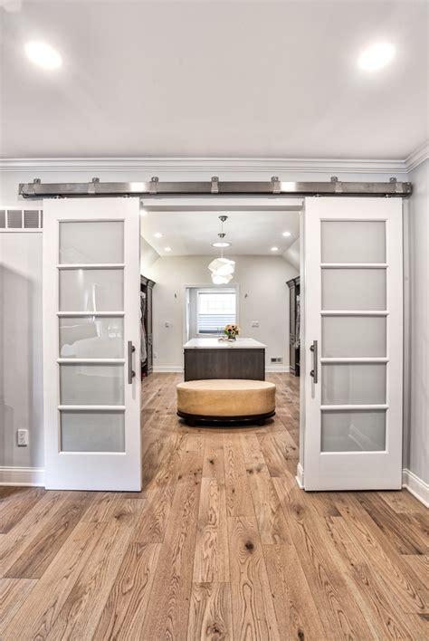 large walk  closet  double sliding barn doors