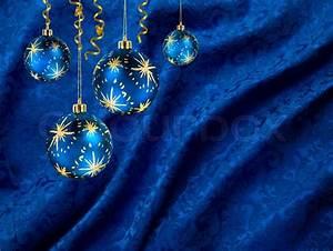 Blue gold christmas balls on blue velvet background