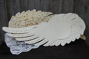 ivory angel wings wall decor the vintage artistry With kitchen cabinets lowes with metal angel wings wall art