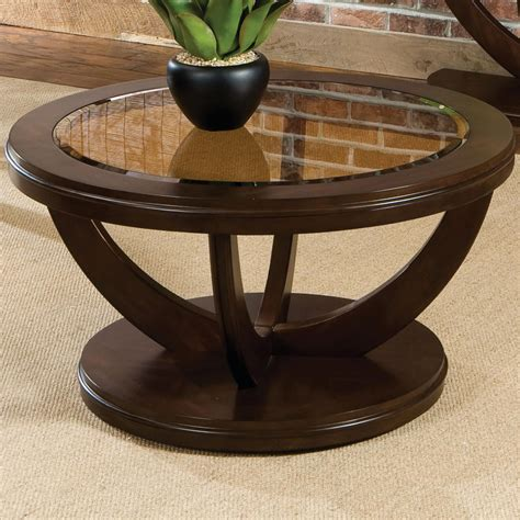 The round glass coffee table is a huge improvement to any living room decor, and one that you will surely appreciate. La Jolla Round Cocktail Table by Standard Furniture ...