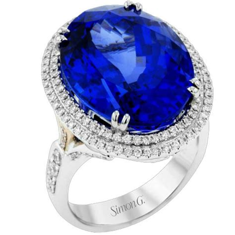 simon   white gold large oval tanzanite diamond halo ring