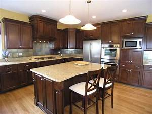 contemporary kitchen with light granite counters dark wood island 2327