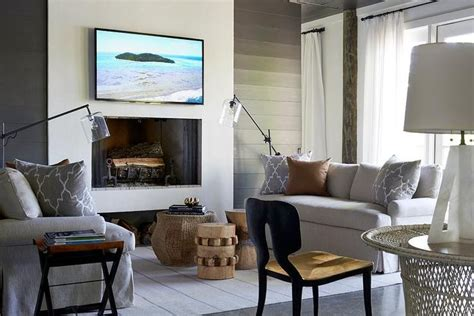 modern cottage living room features black shiplap walls